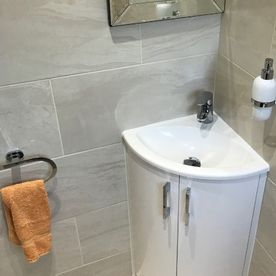 Stone Heat Ltd - Bathrooms - Bathroom Installation - Corner Sink - Loughton