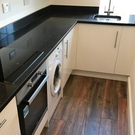 Stone Heat Ltd - Kitchen - Kitchen Installation - Modern Kitchen Floor - Loughton