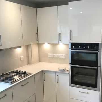 Stone Heat Ltd - Kitchens- white kitchen cupboards with lights - Loughton